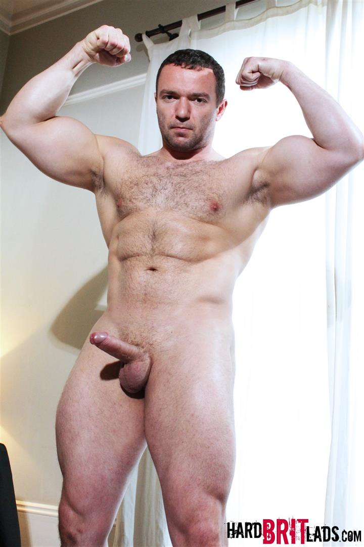 Muscle hunk plays with his cock